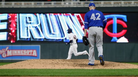 <p>               Toronto Blue Jays pitcher Matt Shoemaker, right, returns to the mound as Minnesota Twins' C.J. Cron rounds the bases on a three-run home run in the fourth inning of a baseball game Monday, April 15, 2019, in Minneapolis. (AP Photo/Jim Mone)             </p>
