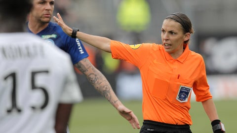 <p>               French referee Stephanie Frappart, right, in action during the French League One soccer match between Amiens and Strasbourg, at the Stade de la Licorne stadium in Amiens, France, Sunday, April 28, 2019. Stephanie Frappart is the first woman to referee a Ligue One soccer match in France. (AP Photo/Michel Spingler)             </p>
