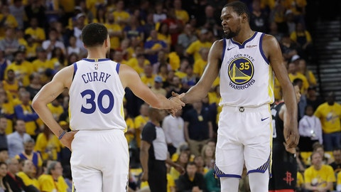 <p>               Golden State Warriors guard Stephen Curry (30) reacts with forward Kevin Durant (35) during the first half of Game 1 of a second-round NBA basketball playoff series against the Houston Rockets in Oakland, Calif., Sunday, April 28, 2019. (AP Photo/Jeff Chiu)             </p>