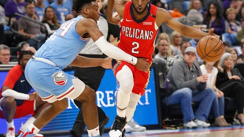 <p>               Sacramento Kings guard Buddy Hield, left, tries to stop New Orleans Pelicans guard Ian Clark during the first half of an NBA basketball game Sunday, April 7, 2019, in Sacramento, Calif. (AP Photo/Rich Pedroncelli)             </p>