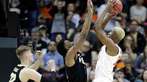 <p>               Virginia's Mamadi Diakite shoots over Purdue's Aaron Wheeler, center, and Matt Haarms (32) during the second half of the men's NCAA Tournament college basketball South Regional final game, Saturday, March 30, 2019, in Louisville, Ky. (AP Photo/Michael Conroy)             </p>