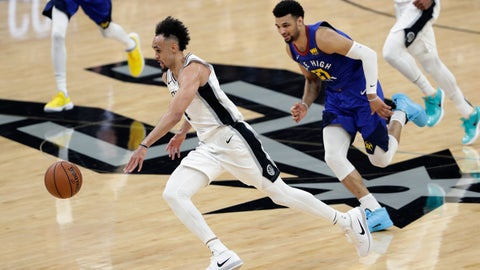 <p>               San Antonio Spurs guard Derrick White (4) drives past Denver Nuggets guard Jamal Murray (27) during the first half of Game 3 of an NBA basketball playoff series in San Antonio, Thursday, April 18, 2019. (AP Photo/Eric Gay)             </p>