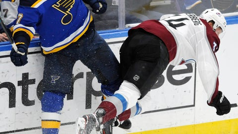 <p>               Colorado Avalanche's Carl Soderberg (34), of Sweden, is checked by St. Louis Blues' Pat Maroon (7) during the third period of an NHL hockey game, Monday, April 1, 2019, in St. Louis. (AP Photo/Bill Boyce)             </p>