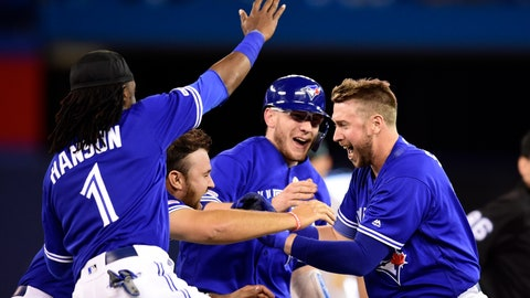 <p>               Toronto Blue Jays first baseman Justin Smoak, right, is mobbed by teammates after driving in the winning run against the Oakland Athletics during 11th-inning baseball game action in Toronto, Sunday, April 28, 2019. (Frank Gunn/The Canadian Press via AP)             </p>
