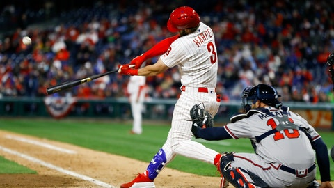 <p>               Philadelphia Phillies' Bryce Harper, left, hits a homerun off Atlanta Braves relief pitcher Shane Carle during the seventh inning of a baseball game, Sunday, March 31, 2019, in Philadelphia. At right is catcher Brian McCann. (AP Photo/Matt Slocum)             </p>