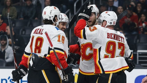 <p>               Calgary Flames forward Sam Bennett (93) celebrates his goal with teammates during the first period of an NHL hockey game against Los Angeles Kings, Monday, April 1, 2019, in Los Angeles. (AP Photo/Ringo H.W. Chiu)             </p>