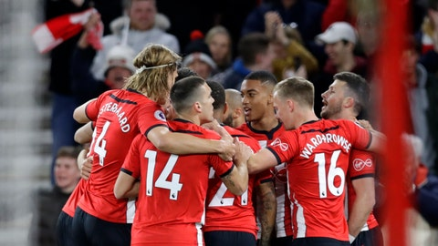 <p>               Southampton's Shane Long celebrates with teammates after scoring his side's opening goal during the English Premier League soccer match between Southampton and Liverpool at St Mary's stadium in Southampton, England Friday, April 5, 2019. (AP Photo/Kirsty Wigglesworth)             </p>