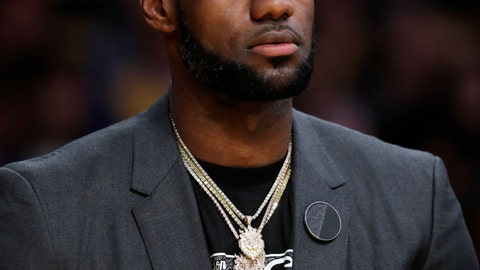 <p>               Los Angeles Lakers' LeBron James wears a T-shirt with the likeness of slain rapper Nipsey Hussle during the first half of the team's NBA basketball game against the Golden State Warriors on Thursday, April 4, 2019, in Los Angeles. (AP Photo/Marcio Jose Sanchez)             </p>