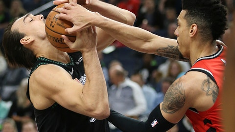 <p>               Minnesota Timberwolves' Dario Saric fights for possession of the ball against Toronto Raptors' Danny Green in the first half of an NBA basketball game Tuesday April 9, 2019, in Minneapolis. (AP Photo/Stacy Bengs)             </p>