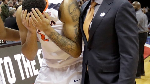 <p>               FILE- In this March 16, 2018, file photo, Virginia's Isaiah Wilkins, left, walks off the court after the team's 74-54 loss to UMBC in a first-round game in the NCAA men's college basketball tournament in Charlotte, N.C. Virginia's basketball program, which gave us one of the sport's greatest players in Ralph Sampson and its two biggest upsets, by Division II Chaminade and the world's most famous 16 seed in UMBC, is now on the verge of writing a new chapter _ one that would not be appreciated by nearly as many people were it not for the huge platform Virginia hoops helped create. (AP Photo/Gerry Broome, File)             </p>