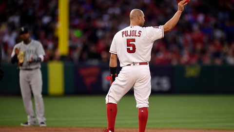 <p>               Los Angeles Angels' Albert Pujols, right, tips his helmet to fans after hitting an RBI double as Seattle Mariners shortstop Tim Beckham claps during the third inning of a baseball game Saturday, April 20, 2019, in Anaheim, Calif. With that RBI, Pujols tied Babe Ruth for 5th place on the all-time RBI list with 1,992. (AP Photo/Mark J. Terrill)             </p>