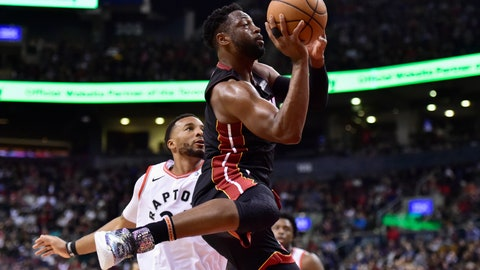 <p>               Miami Heat guard Dwyane Wade (3) drives past Toronto Raptors forward Norman Powell (24) on his way to the net during second-half NBA basketball action in Toronto, Sunday, April 7, 2019. (Frank Gunn/The Canadian Press via AP)             </p>