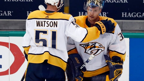 <p>               Nashville Predators' Austin Watson (51) taps goaltender Pekka Rinne, right, on the shoulder as they stand by the bench following their 2-1 overtime loss to the Dallas Stars in Game 6 of an NHL hockey first-round playoff series in Dallas, Monday, April 22, 2019. (AP Photo/Tony Gutierrez)             </p>