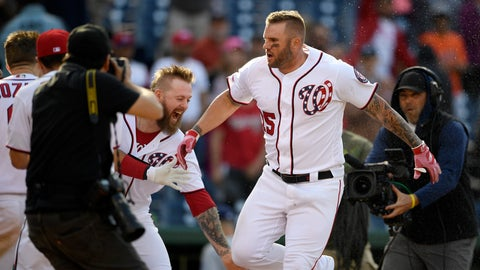 <p>               Washington Nationals' Matt Adams, right, celebrates as he heads home after hitting a walk-off home run during the 11th inning of a baseball game against the San Diego Padres, Sunday, April 28, 2019, in Washington. The Nationals won 7-6 in 11 innings. (AP Photo/Nick Wass)             </p>