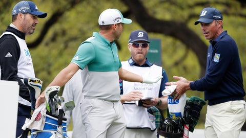 <p>               Sergio Garcia, second from left and Matt Kuchar, right, discuss on the eighth hole what had happened on the seventh green, during the Dell Technologies Match Play Championship golf tournament, Saturday, March 30, 2019, in Austin, Texas. Garcia had an 8-foot putt to win the seventh hole and left it 4 inches short, a frustrating miss. Worse yet was what followed. Such a tap-in typically is conceded in the Dell Technologies Match Play, and the Spaniard walked up and casually rapped it left-handed. The ball spun around the cup, and he picked it up and walked off the green, assuming he remained 1 down through seven holes. One problem: Matt Kuchar never formally conceded the putt. (AP Photo/Eric Gay)             </p>