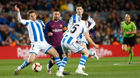 <p>               Barcelona forward Lionel Messi fights for the ball against Real Sociedad's Diego Llorente, left and Aritz Elustondo during a Spanish La Liga soccer match between FC Barcelona and Real Sociedad at the Camp Nou stadium in Barcelona, Spain, Saturday, April 20, 2019. (AP Photo/Joan Monfort)             </p>