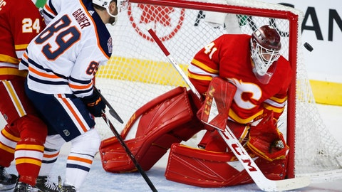 <p>               Edmonton Oilers' Sam Gagner, left, has his shot deflected by Calgary Flames goalie Mike Smith during the first period of an NHL hockey game Saturday, April 6, 2019, in Calgary, Alberta. (Jeff McIntosh/The Canadian Press via AP)             </p>