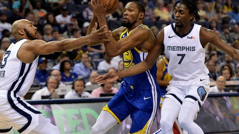 <p>               Golden State Warriors forward Kevin Durant (35) drives between Memphis Grizzlies guard Jevon Carter (3) and forward Justin Holiday (7) during the first half of an NBA basketball game Wednesday, April 10, 2019, in Memphis, Tenn. (AP Photo/Brandon Dill)             </p>