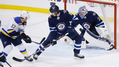 <p>               St. Louis Blues' Jaden Schwartz (17) scores the against Winnipeg Jets goaltender Connor Hellebuyck (37) as Jets' Jacob Trouba (8) defends in the final minute of Game 5 of an NHL hockey first-round playoff series Thursday, April 18, 2019, in Winnipeg, Manitoba. (John Woods/The Canadian Press via AP)             </p>