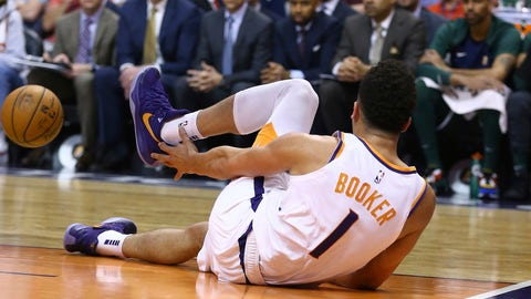 <p>               An injured Phoenix Suns guard Devin Booker reaches for his ankle after turning it during the first half of the team's NBA basketball against the Utah Jazz on Wednesday, April 3, 2019, in Phoenix. (AP Photo/Ross D. Franklin)             </p>