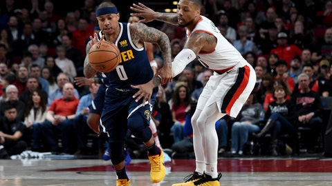 <p>               Denver Nuggets guard Isaiah Thomas, left, knocks the ball away from Portland Trail Blazers guard Damian Lillard during the first half of an NBA basketball game in Portland, Ore., Sunday, April 7, 2019. (AP Photo/Steve Dykes)             </p>