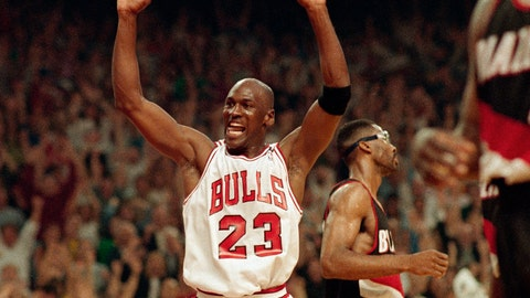 <p>               FILE - In this June 14, 1992, file photo, Michael Jordan celebrates the Bulls win over the Portland Trail Blazers in the NBA Finals in Chicago. Decades after Jordan's groundbreaking departure from college, March Madness and the NBA's mega-millions have taken all the novelty out of leaving early for the pros. (AP Photo/John Swart, File)             </p>