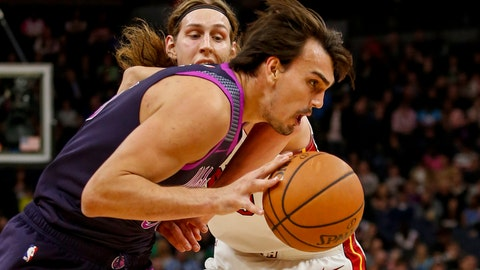 <p>               Minnesota Timberwolves forward Dario Saric, front, drives to the basket around Miami Heat forward Kelly Olynyk in the first quarter of an NBA basketball game Friday, April 5, 2019, in Minneapolis. (AP Photo/Bruce Kluckhohn)             </p>