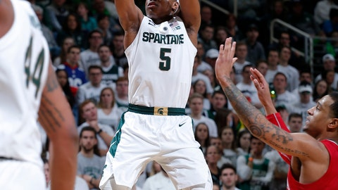 <p>               FILE - In this Feb. 2, 2019, file photo, Michigan State's Cassius Winston (5) shoots past Indiana's Devonte Green, right, during the second half of an NCAA college basketball game, in East Lansing, Mich. Winston has joined a select group of players in program history as an All-America player and Big Ten player of the year. If he can help the Spartans win two more games, he'll join Magic Johnson and Mateen Cleaves as the school's national championship-winning point guards. (AP Photo/Al Goldis, File)             </p>