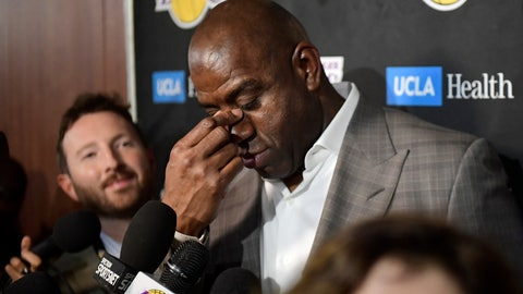 <p>               Magic Johnson wipes his eyes as he speaks to reporters prior to an NBA basketball game between the Los Angeles Lakers and the Portland Trail Blazers on Tuesday, April 9, 2019, in Los Angeles. Johnson abruptly quit as the Lakers' president of basketball operations Tuesday night, citing his desire to return to the simpler life he enjoyed as a wealthy businessman and beloved former player before taking charge of the franchise just over two years ago. (AP Photo/Mark J. Terrill)             </p>