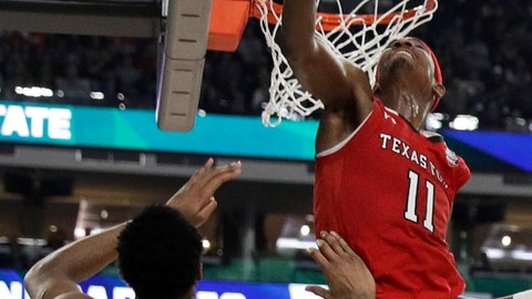 <p>               Texas Tech forward Tariq Owens (11) blocks a shot by Michigan State forward Xavier Tillman during the first half in the semifinals of the Final Four NCAA college basketball tournament, Saturday, April 6, 2019, in Minneapolis. (AP Photo/David J. Phillip)             </p>