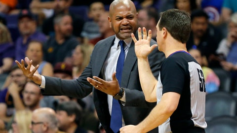 <p>               Memphis Grizzlies head coach J.B. Bickerstaff talks to NBA official Scott Twardoski in the first half during an NBA basketball game against the Phoenix Suns, Saturday, March 30, 2019, in Phoenix. (AP Photo/Rick Scuteri)             </p>