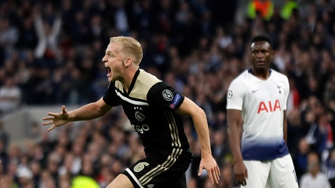 <p>               Ajax's Donny van de Beek celebrates after scoring his side's opening goal during the Champions League semifinal first leg soccer match between Tottenham Hotspur and Ajax at the Tottenham Hotspur stadium in London, Tuesday, April 30, 2019. (AP Photo/Kirsty Wigglesworth)             </p>