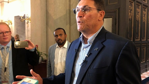 <p>               Carolina Panthers coach Ron Rivera talks to reporters as he visits the South Carolina Statehouse, Thursday, April 11, 2019, in Columbia, S.C. Rivera was talking to lawmakers about a bill to provide about $120 million in incentives to get the NFL football team to move its practice fields and headquarters to South Carolina (AP Photo/Jeffrey Collins)             </p>