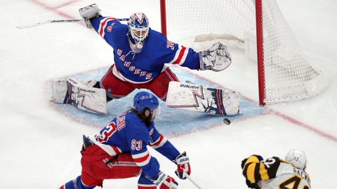 <p>               New York Rangers goaltender Henrik Lundqvist (30) stretches to make a save on a shot by Boston Bruins right wing David Backes (42) during the third period of an NHL hockey game in Boston, Wednesday, March 27, 2019. At lower left is New York Rangers center Mika Zibanejad. (AP Photo/Charles Krupa)             </p>
