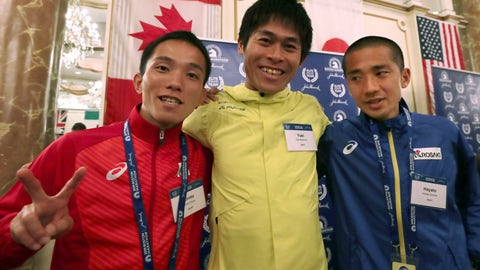 <p>               Elite runners Hiroto Inoue, left, Yuki Kawauchi, center, and Hayato Sonoda, all of Japan, pose for a photo after a media availability on Friday, April 12, 2019, in Boston in advance of the 123rd Boston Marathon on Monday. Kawauchi won the race in 2018. (AP Photo/Charles Krupa)             </p>