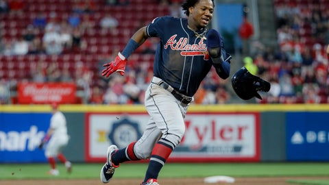 <p>               Atlanta Braves' Ronald Acuna Jr. runs home to score on an error by Cincinnati Reds right fielder Yasiel Puig (66) in the fifth inning of a baseball game, Wednesday, April 24, 2019, in Cincinnati. (AP Photo/John Minchillo)             </p>