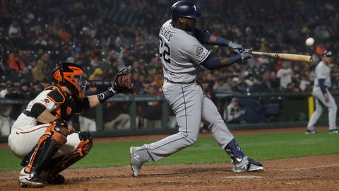 <p>               San Diego Padres' Franmil Reyes, right, hits a two-run home run in front of San Francisco Giants catcher Buster Posey during the seventh inning of a baseball game in San Francisco, Monday, April 8, 2019. (AP Photo/Jeff Chiu)             </p>