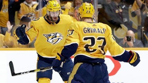 <p>               Nashville Predators center Rocco Grimaldi (23) celebrates with Austin Watson (51) after scoring a goal against the Dallas Stars during the second period in Game 2 of an NHL hockey first-round playoff series Saturday, April 13, 2019, in Nashville, Tenn. (AP Photo/Mark Humphrey)             </p>