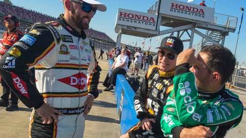 <p>               NASCAR Cup Series driver Austin Dillon, left, talks with fellow drivers Daniel Hemric, center, and Kyle Larson before qualifying for a NASCAR Cup Series auto race at Talladega Superspeedway, Saturday, April 27, 2019, in Talladega, Ala. (AP Photo/Julie Bennett)             </p>
