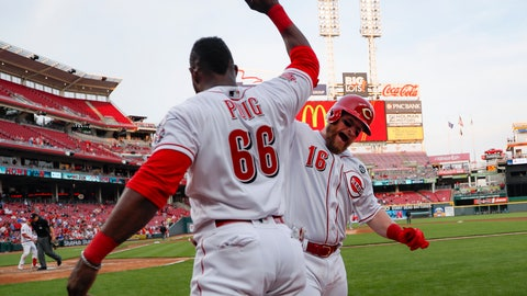 <p>               Cincinnati Reds' Tucker Barnhart (16) celebrates with Yasiel Puig (66) after hitting a solo home run off Atlanta Braves starting pitcher Kevin Gausman in the fourth inning of a baseball game, Tuesday, April 23, 2019, in Cincinnati. (AP Photo/John Minchillo)             </p>