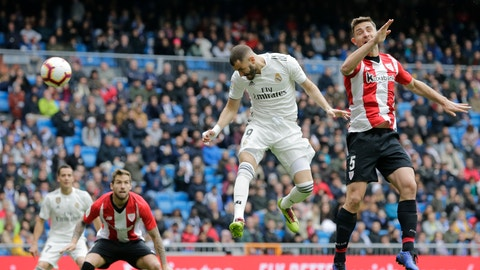 <p>               Real Madrid's Karim Benzema heads for the ball to score during a Spanish La Liga soccer match between Real Madrid and Athletic Bilbao at the Santiago Bernabeu stadium in Madrid, Spain, Sunday, April 21, 2019. (AP Photo/Bernat Armangue)             </p>