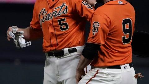 <p>               San Francisco Giants' Erik Kratz (5) and Brandon Belt, right, celebrate at the end of an 18 inning baseball game against the Colorado Rockies Saturday, April 13, 2019, in San Francisco. (AP Photo/Ben Margot)             </p>