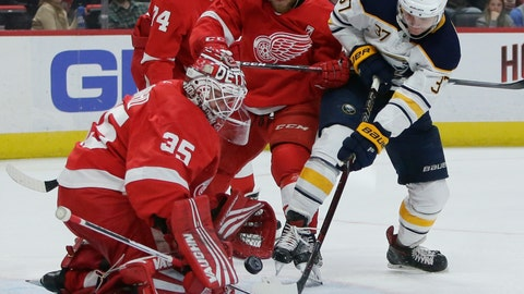 <p>               Detroit Red Wings goaltender Jimmy Howard (35) stops a shot on goal by Buffalo Sabres center Casey Mittelstadt (37) with Detroit Red Wings defenseman Joe Hicketts (2) helping defend the goal during the first period of an NHL hockey game Saturday, April 6, 2019, in Detroit. (AP Photo/Duane Burleson)             </p>