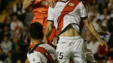 <p>               Real Madrid's Gareth Bale, left and Rayo Vallecano's Mario Suarez jump for the ball during a Spanish La Liga soccer match between Rayo Vallecano and Real Madrid at the Vallecas stadium in Madrid, Spain, Sunday, April 28, 2019. (AP Photo/Paul White)             </p>