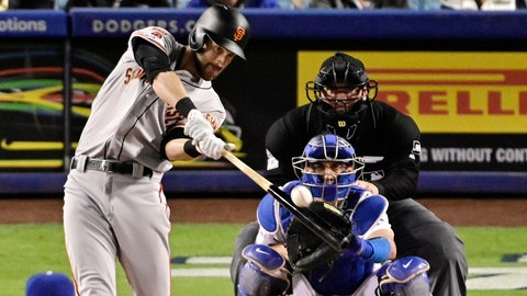 <p>               San Francisco Giants' Steven Duggar hits a solo home run as Los Angeles Dodgers catcher Austin Barnes and home plate umpire Dan Bellino watch during the fourth inning of a baseball game Wednesday, April 3, 2019, in Los Angeles. (AP Photo/Mark J. Terrill)             </p>