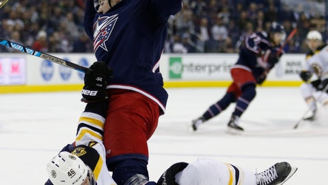 <p>               Boston Bruins forward David Krejci, bottom, of the Czech Republic, gets tangled with Columbus Blue Jackets forward Pierre-Luc Dubois during the first period of an NHL hockey game in Columbus, Ohio, Tuesday, April 2, 2019. (AP Photo/Paul Vernon)             </p>