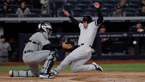 <p>               New York Yankees' Luke Voit beats the throw home to Detroit Tigers catcher Grayson Greiner to score on a hit to left field and a fielding error by Detroit Tigers left fielder Christin Stewart during the third inningof a baseball game, Monday, April 1, 2019, in New York. (AP Photo/Julie Jacobson)             </p>