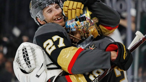 <p>               Vegas Golden Knights defenseman Shea Theodore, left, embraces goaltender Marc-Andre Fleury after the team's win over the San Jose Sharks in Game 4 of a first-round NHL hockey playoff series Tuesday, April 16, 2019, in Las Vegas. (AP Photo/John Locher)             </p>