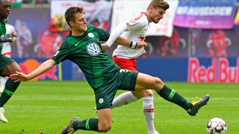 <p>               Wolfsburg's Robin Knoche, left, challenges for the ball against Leipzig's Timo Werner, right, during the German Bundesliga soccer match between RB Leipzig and VfL Wolfsburg in Leipzig, Germany, Saturday, April 13, 2019. (AP Photo/Jens Meyer)             </p>