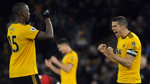 <p>               Wolverhampton's Conor Coady, right, and Willy Boly, left, celebrate at the end of the English Premier League soccer match between Wolverhampton Wanderers and Manchester United at the Molineux Stadium in Wolverhampton, England, Tuesday, April 2, 2019. Wolverhampton won 2-1. (AP Photo/Rui Vieira)             </p>